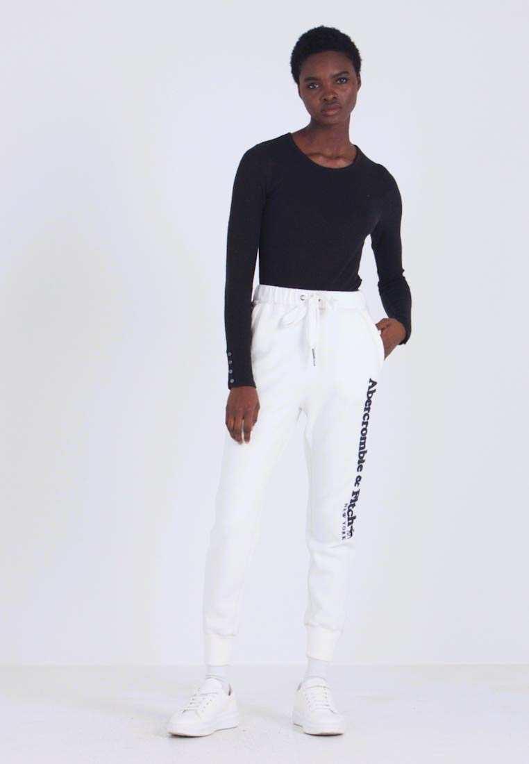 Abercrombie & Fitch - LONG LIFE - Tracksuit bottoms - white - 1