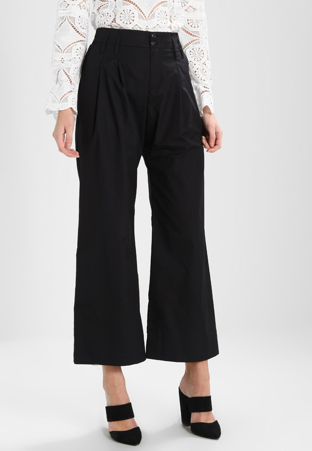 HEAVY - Trousers - black