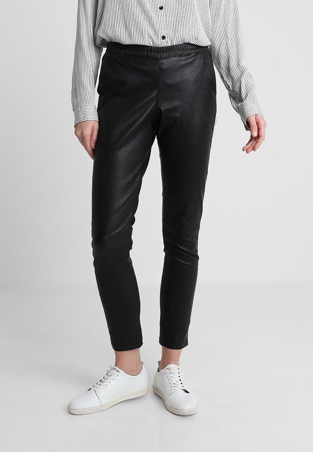 FUN - Trousers - black