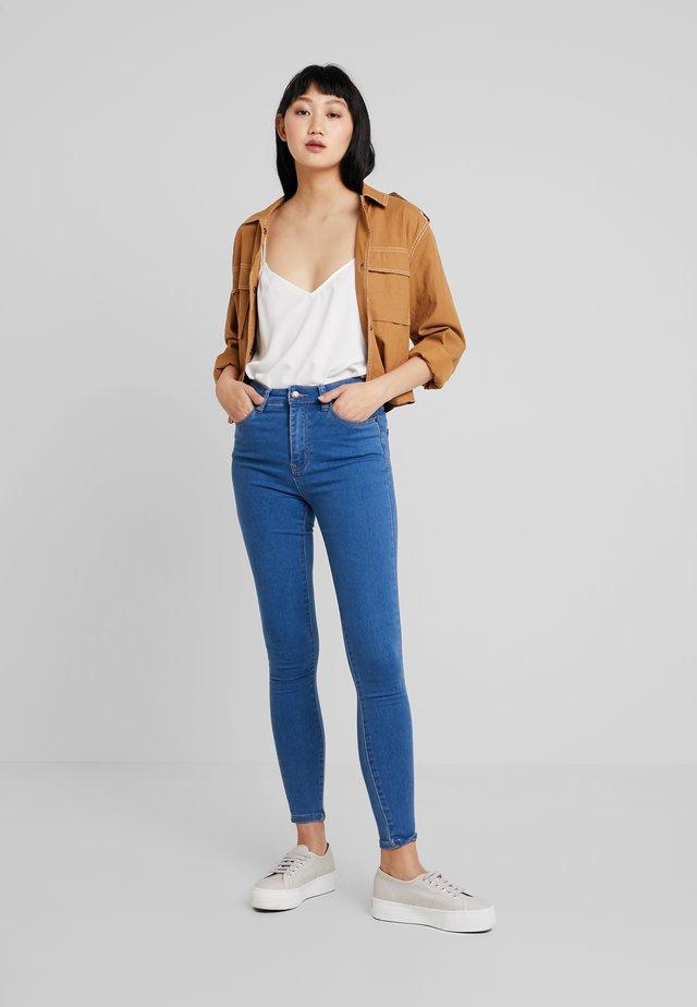 Jeansy Skinny Fit - mid blue denim