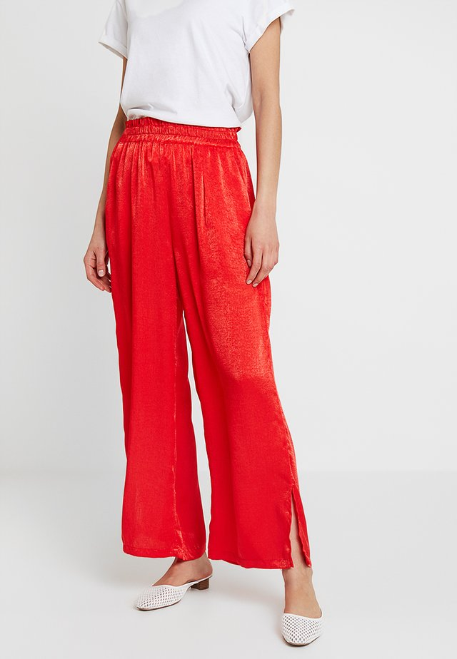 SIANA LONG FLARED PANTS - Trousers - patrol red