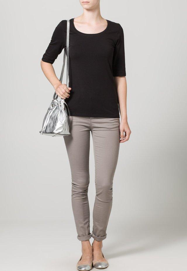 SANIKA - T-shirt basique - black