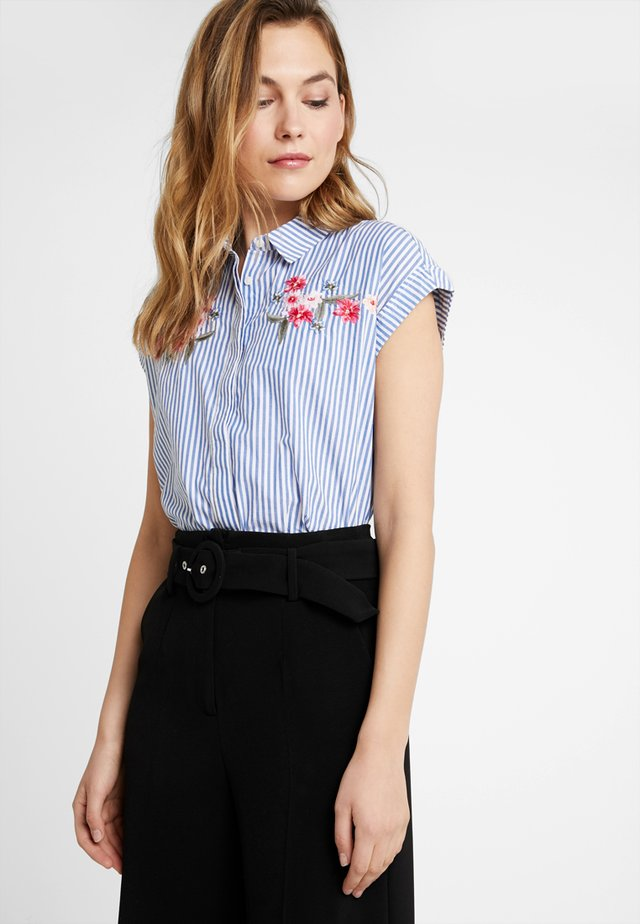 BLOUSE WITH EMBROIDERY - Button-down blouse - lightblue