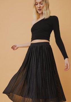 Plisserade kjolar