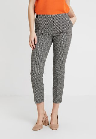 EDIRA - Trousers - black