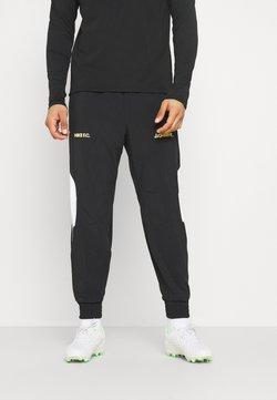 Nike Performance - FC PANT - Jogginghose - black/white/saturn gold