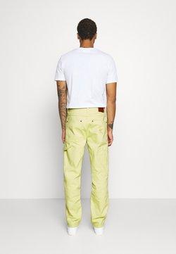 Karl Kani - PANTS  - Jean boyfriend - yellow