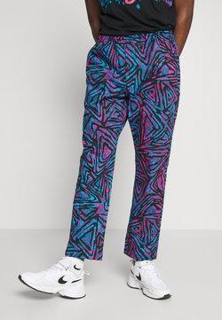 Nike SB - M NK SB PANT AOP - Trousers - laser blue/black/laser blue