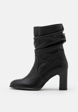 Unisa - ULANO - Stiefelette - black creamy
