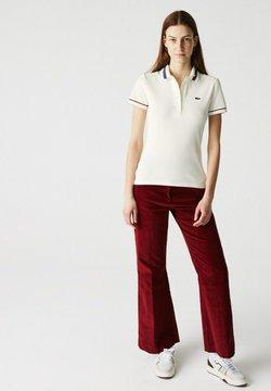 Lacoste - Poloshirt - blanc / rouge / bleu