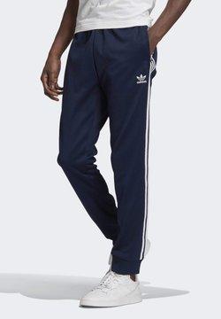 adidas Originals - ADICOLOR CLASSICS PRIMEBLUE SST TRACKSUIT BOTTOM - Jogginghose - blue