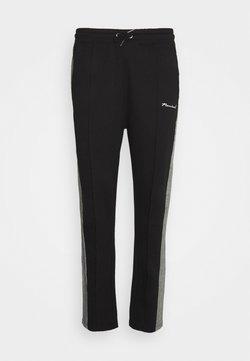Nominal - CHECK TAPE  - Jogginghose - black