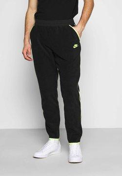 Nike Sportswear - PANT WINTER - Jogginghose - black/volt