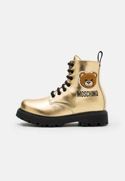 MOSCHINO - Schnürstiefelette - gold