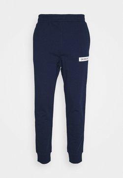 Calvin Klein Performance - PANTS - Jogginghose - blue