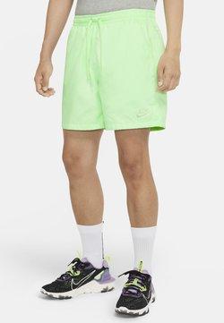 Nike Sportswear - FLOW - Shorts - vapour green/vapour green