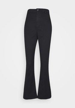 Vero Moda Curve - VMMARIA  - Flared jeans - black