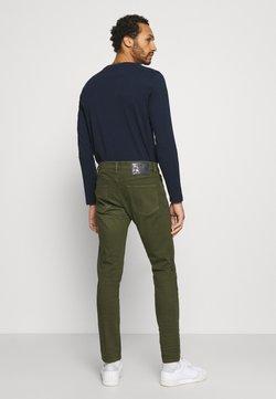 Diesel - D-STRUKT - Jeans Skinny Fit - olive