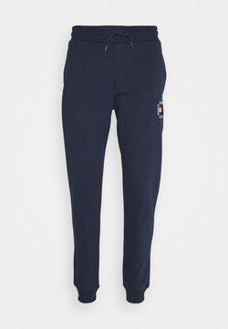Tommy Jeans - SLIM BOX FLAG PANT - Jogginghose - blue