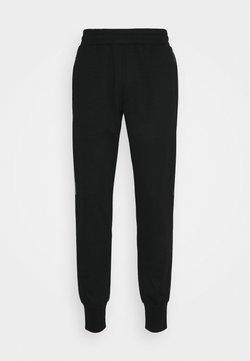 Jack & Jones - JCOZHALF TAPE PANTS - Verryttelyhousut - black