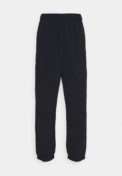 Nike SB - NOVELTY TRACK PANT UNISEX - Jogginghose - black