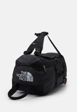 The North Face - BASE CAMP DUFFEL ROLLER - Bolsa de viaje - black