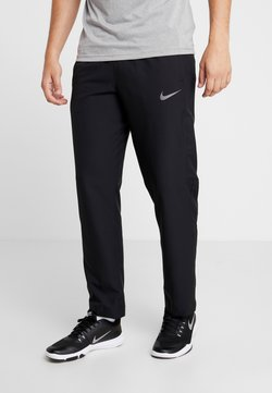 Nike Performance - DRY PANT TEAM - Jogginghose - black/hematite