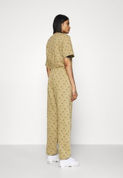 Nike Sportswear - W NSW PANT BB AOP PRNT PACK - Jogginghose - parachute beige