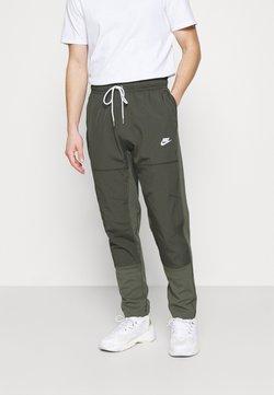 Nike Sportswear - PANT - Jogginghose - twilight marsh/newsprint/ice silver/white