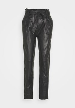 JUST FEMALE - SAGO TROUSERS - Leather trousers - black