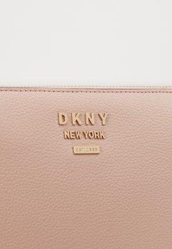 DKNY - WHITNEY FLAT CROSSBODY - Torba na ramię - light pink