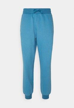 Curare Yogawear - LONG PANTS - Jogginghose - light blue