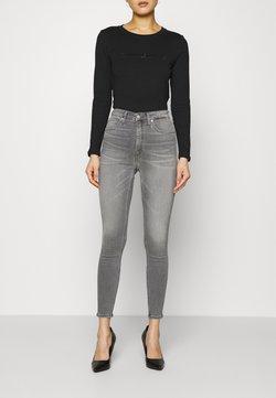 Calvin Klein Jeans - HIGH RISE SUPER SKINNY ANKLE - Jeans Skinny Fit - denim black