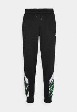 Puma - BORUSSIA MÖNCHENGLADBACH ICONIC GRAPHIC TRACK PANTS - Vereinsmannschaften - black/white/amazon green