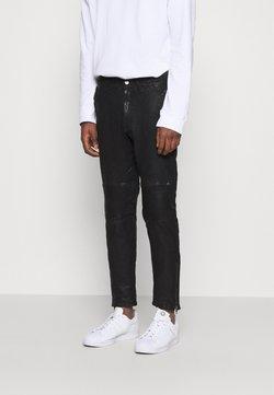Tigha - ADEEL - Trousers - black