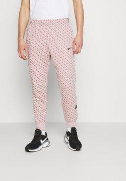 Nike Sportswear - REPEAT PRINT - Jogginghose - champagne/smokey mauve/black