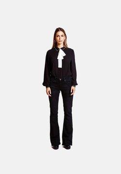 Jacky Luxury - Flared Jeans - black