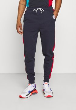 Tommy Jeans - MIX MEDIA BASKETBALL PANT - Jogginghose - twilight navy