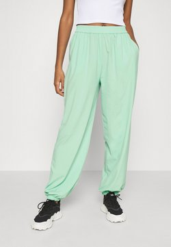 NA-KD - NA-KD X ZALANDO EXCLUSIVE - SPORTY FABRIC PANTS - Jogginghose - fresh mint