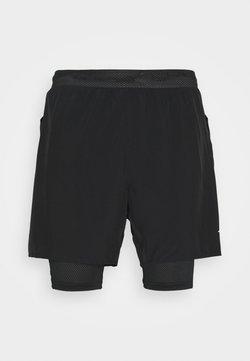 Mizuno - Pantalón corto de deporte - black