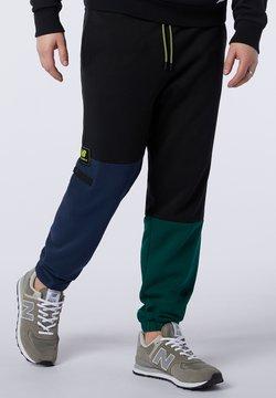 New Balance - ATHLETICS - Jogginghose - nightwatch green
