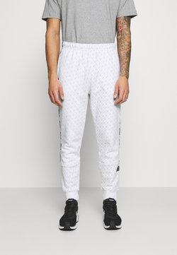 Nike Sportswear - REPEAT PRINT - Jogginghose - white/black