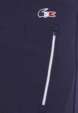 Lacoste Sport - OLYMP PANT - Träningsbyxor - navy blue/white