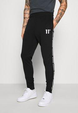11 DEGREES - TAPED TRACK PANTS - Jogginghose - black