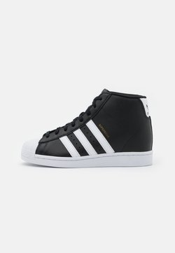 adidas Originals - SUPERSTAR SPORTS INSPIRED MID SHOES - Sneakersy wysokie - core black/footwear white/gold metallic