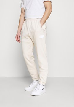 adidas Originals - PANT UNISEX - Jogginghose - halo ivory