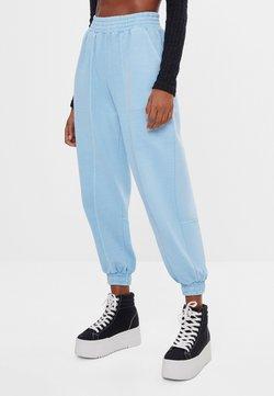 Bershka - Spodnie treningowe - blue