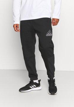 adidas Performance - ESSENTIALS RELAXED - Spodnie treningowe - black