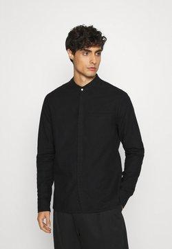 Tigha - PHARRRELL - Camicia - black