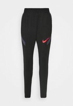 Nike Performance - STRIKE PANT  - Jogginghose - black/dark raisin/siren red